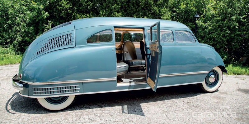 The car has four windows and one doors on each side, one for the driver and a central one for the passengers