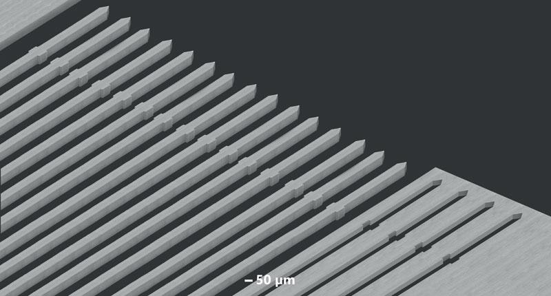 """5. Esempio delle capacità di microlavorazione della società Posalux: fori quadrati 30x30 micron su nitruro di silicio (a, b, c) e """"routing"""" di sonde verticali e MEMS"""