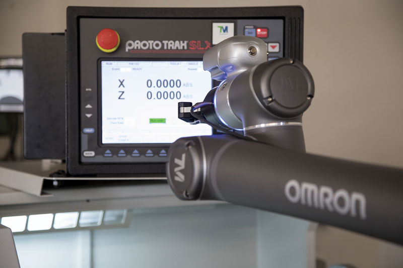The cobot is checking a monitor with its camera.