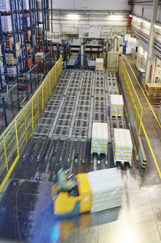 The low lift trucks pick up the pallets and load them on the freight trucks.
